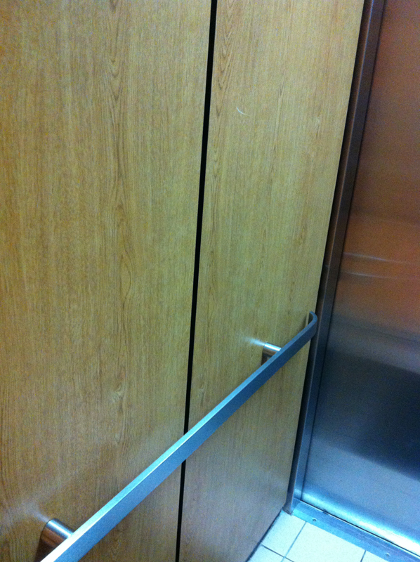 Handrail in home elevator